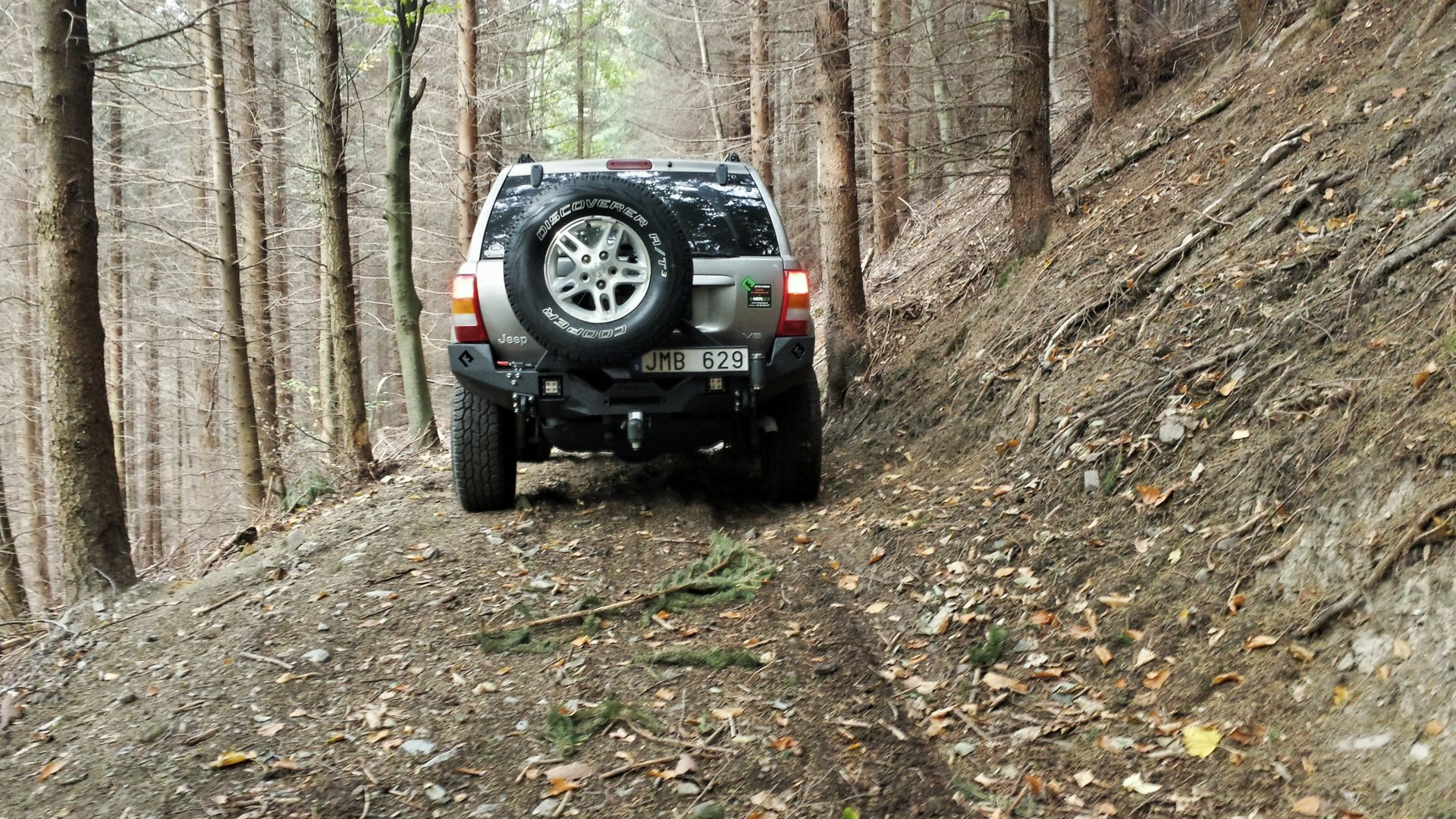 Jeep WJ with Metalpasja rear bumper in the forest
