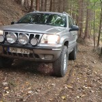 Jeep WJ with Metalpasja rear bumper in the forest, Front, Czech Republic
