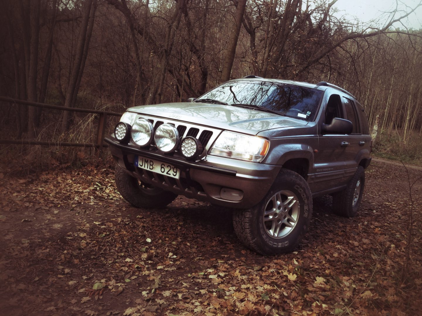 Jeep WJ posing on bridge, Close, filter