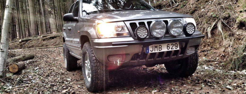 Jeep WJ on lumber trail, close