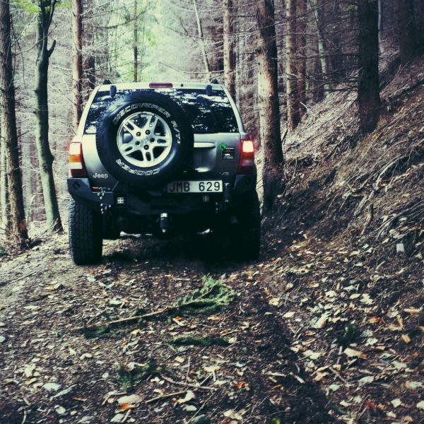 Jeep WJ with Metalpasja rear bumper in the forest, Czech Republic