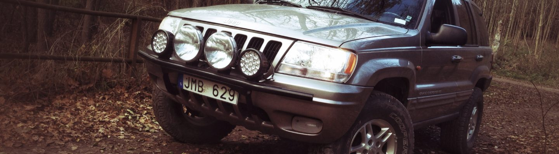 Jeep WJ posing on bridge, Close, filter